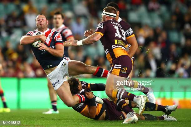 Boyd Cordner of the Roosters is tackled during the NRL Qualifying Final match between the Sydney Roosters and the Brisbane Broncos at Allianz Stadium...