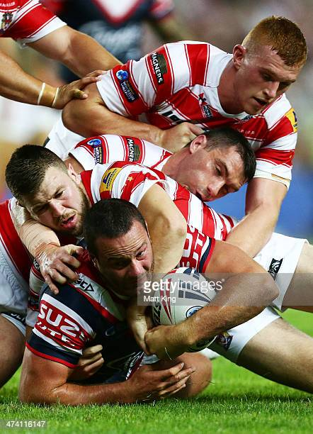 Boyd Cordner of the Roosters is tackled during the NRL World Club Challenge match between the Sydney Roosters and the Wigan Warriors at Allianz...