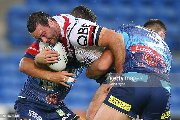 Boyd Cordner of the Roosters is tackled during the round 10 NRL match between the Gold Coast Titans and the Sydney Roosters at Cbus Super Stadium on...