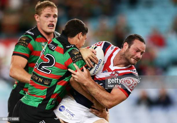 Boyd Cordner of the Roosters is tackled during the round four NRL match between the South Sydney Rabbitohs and the Sydney Roosters at ANZ Stadium on...