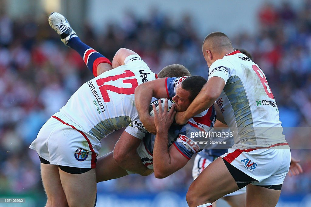 Boyd Cordner of the Roosters is tackled during the round seven NRL match between the Sydney Roosters and the St George Illawarra Dragons at Allianz Stadium on April 25, 2013 in Sydney, Australia.