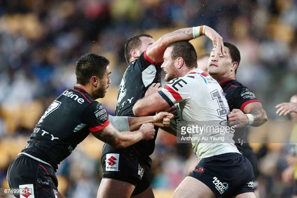 Boyd Cordner of the Roosters runs into Bodene Thompson Shaun Johnson and Issac Luke of the Warriors during the round nine NRL match between the New...