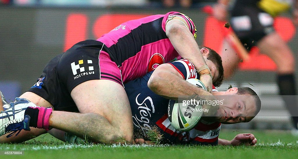 <a gi-track='captionPersonalityLinkClicked' href=/galleries/search?phrase=Boyd+Cordner&family=editorial&specificpeople=7857347 ng-click='$event.stopPropagation()'>Boyd Cordner</a> of the Roosters scores a try during the round 19 NRL match between the Sydney Roosters and the Penrith Panthers at Allianz Stadium on July 19, 2014 in Sydney, Australia.