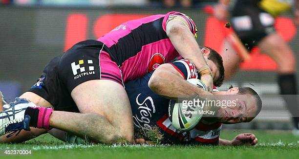 Boyd Cordner of the Roosters scores a try during the round 19 NRL match between the Sydney Roosters and the Penrith Panthers at Allianz Stadium on...