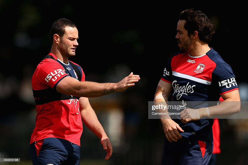 Boyd Cordner of the Roosters talks to team mate Aidan Guerra during a Sydney Roosters NRL training session at Kippax Lake on September 3, 2014 in Sydney, Australia.