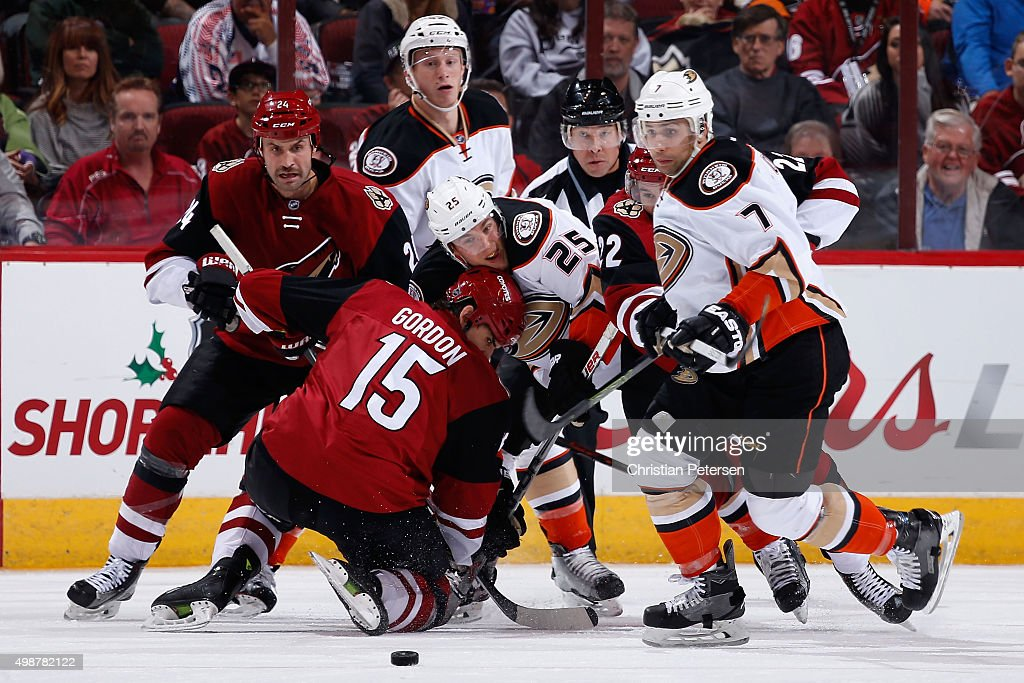 Boyd Gordon of the Arizona Coyotes wins a faceoff against Mike Santorelli of the Anaheim Ducks as Kyle Chipchura and Andrew Cogliano follow the puck...
