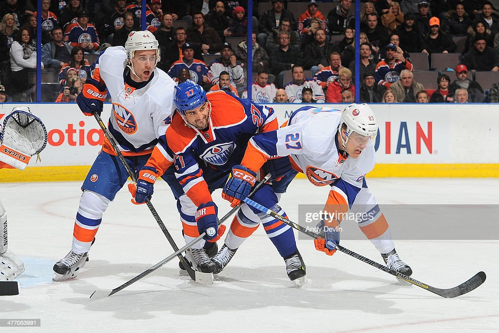 <a gi-track='captionPersonalityLinkClicked' href=/galleries/search?phrase=Boyd+Gordon&family=editorial&specificpeople=209395 ng-click='$event.stopPropagation()'>Boyd Gordon</a> #27 of the Edmonton Oilers battles for position against <a gi-track='captionPersonalityLinkClicked' href=/galleries/search?phrase=Calvin+de+Haan&family=editorial&specificpeople=5660177 ng-click='$event.stopPropagation()'>Calvin de Haan</a> #44 and <a gi-track='captionPersonalityLinkClicked' href=/galleries/search?phrase=Anders+Lee&family=editorial&specificpeople=7630081 ng-click='$event.stopPropagation()'>Anders Lee</a> #27 of the New York Islanders on March 6, 2014 at Rexall Place in Edmonton, Alberta, Canada.