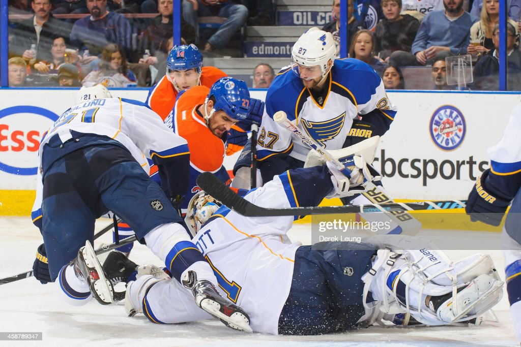 <a gi-track='captionPersonalityLinkClicked' href=/galleries/search?phrase=Boyd+Gordon&family=editorial&specificpeople=209395 ng-click='$event.stopPropagation()'>Boyd Gordon</a> #27 of the Edmonton Oilers fights for the puck as <a gi-track='captionPersonalityLinkClicked' href=/galleries/search?phrase=Patrik+Berglund&family=editorial&specificpeople=540481 ng-click='$event.stopPropagation()'>Patrik Berglund</a> #21, <a gi-track='captionPersonalityLinkClicked' href=/galleries/search?phrase=Alex+Pietrangelo&family=editorial&specificpeople=4072229 ng-click='$event.stopPropagation()'>Alex Pietrangelo</a> #27 and <a gi-track='captionPersonalityLinkClicked' href=/galleries/search?phrase=Brian+Elliott&family=editorial&specificpeople=687032 ng-click='$event.stopPropagation()'>Brian Elliott</a> #1 of the St Louis Blues during an NHL game at Rexall Place on December 21, 2013 in Edmonton, Alberta, Canada.