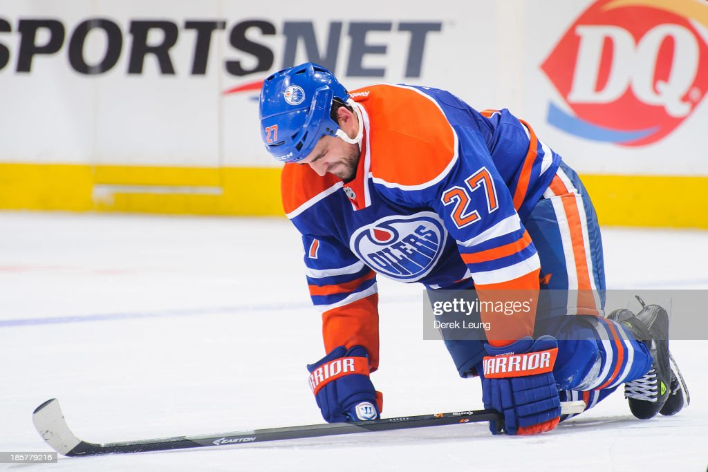 <a gi-track='captionPersonalityLinkClicked' href=/galleries/search?phrase=Boyd+Gordon&family=editorial&specificpeople=209395 ng-click='$event.stopPropagation()'>Boyd Gordon</a> #27 of the Edmonton Oilers reacts to being hurt during play against the Washington Capitals during an NHL game at Rexall Place on October 24, 2013 in Edmonton, Alberta, Canada. The Capitals defeated the Oilers 4-1.