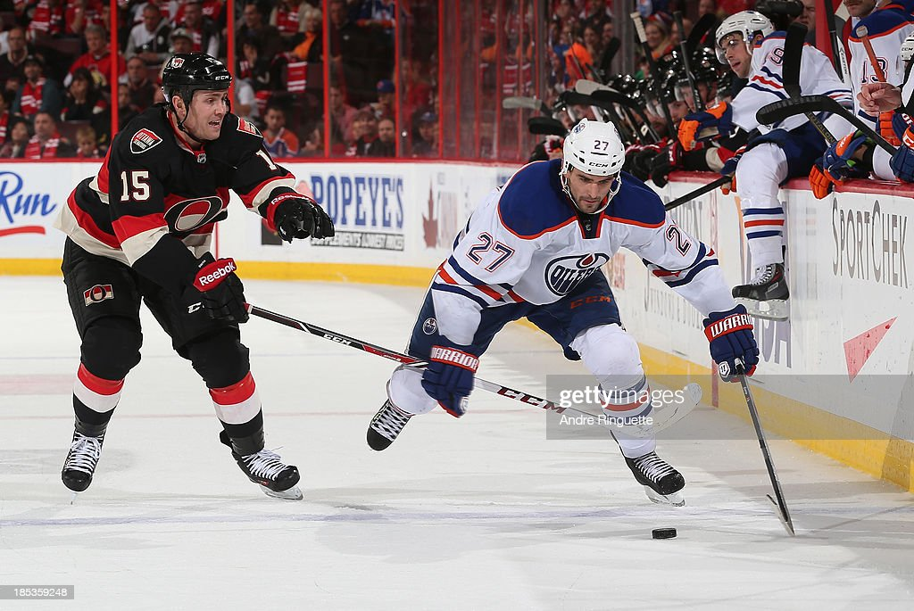 <a gi-track='captionPersonalityLinkClicked' href=/galleries/search?phrase=Boyd+Gordon&family=editorial&specificpeople=209395 ng-click='$event.stopPropagation()'>Boyd Gordon</a> #27 of the Edmonton Oilers stickhandles the puck against Zack Smith #15 of the Ottawa Senators at Canadian Tire Centre on October 19, 2013 in Ottawa, Ontario, Canada.