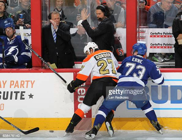 Boyd Gordon of the Philadelphia Flyers battles for the puck along the boards against Adam Erne of the Tampa Bay Lightning on January 7 2017 at the...