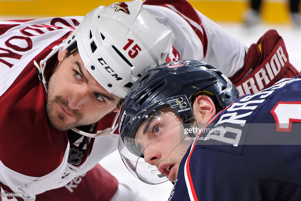 Boyd Gordon #15 of the Phoenix Coyotes and Derick Brassard #16 of the Columbus Blue Jackets look up at the referee before a face off during the second period on March 16, 2013 at Nationwide Arena in Columbus, Ohio.