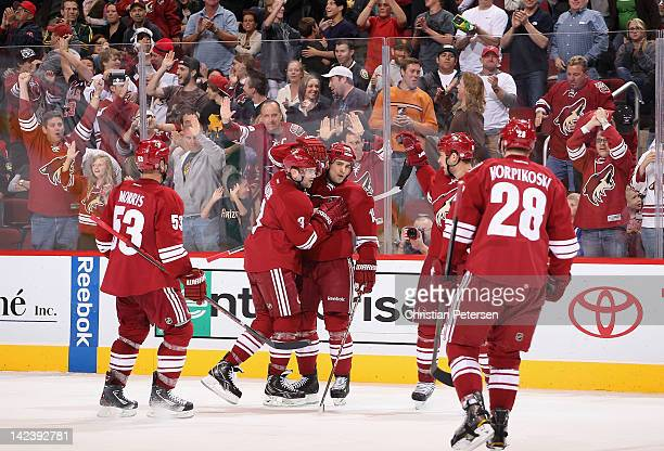 Boyd Gordon of the Phoenix Coyotes celebrates with Derek Morris Keith Yandle Taylor Pyatt and Lauri Korpikoski after Gordon scored a second period...