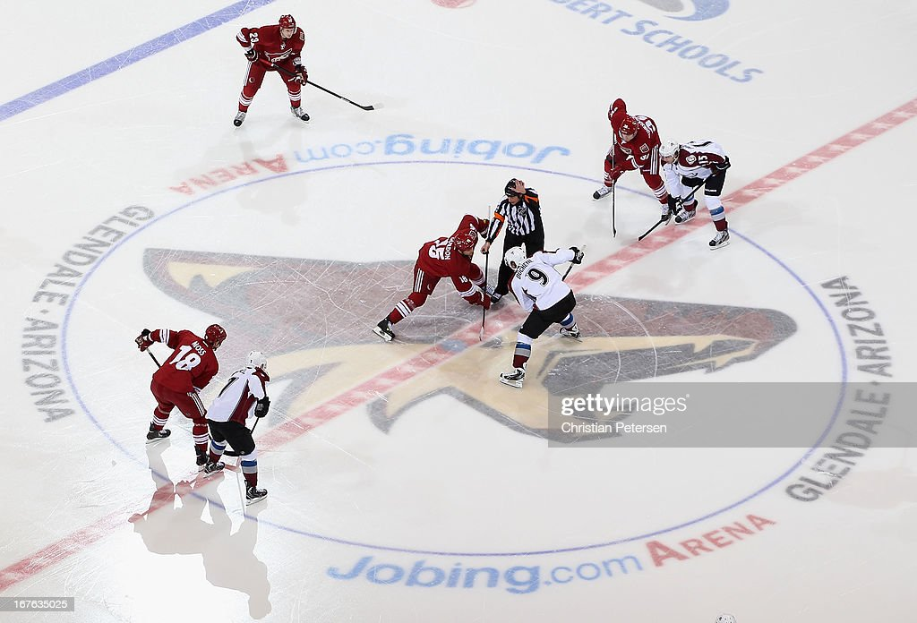 <a gi-track='captionPersonalityLinkClicked' href=/galleries/search?phrase=Boyd+Gordon&family=editorial&specificpeople=209395 ng-click='$event.stopPropagation()'>Boyd Gordon</a> #15 of the Phoenix Coyotes faces off against <a gi-track='captionPersonalityLinkClicked' href=/galleries/search?phrase=Matt+Duchene&family=editorial&specificpeople=4819304 ng-click='$event.stopPropagation()'>Matt Duchene</a> #9 of the Colorado Avalanche to start the NHL game at Jobing.com Arena on April 26, 2013 in Glendale, Arizona. The Avalanche defeated the Coyotes 5-4 in an overtime shoot-out.