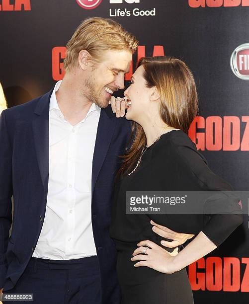 Boyd Holbrook and Elizabeth Olsen arrive at the Los Angeles premiere of 'Godzilla' held at Dolby Theatre on May 8 2014 in Hollywood California