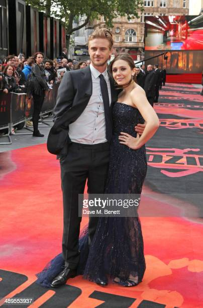 Boyd Holbrook and Elizabeth Olsen attend the European premiere of 'Godzilla' at Odeon Leicester Square on May 11 2014 in London England