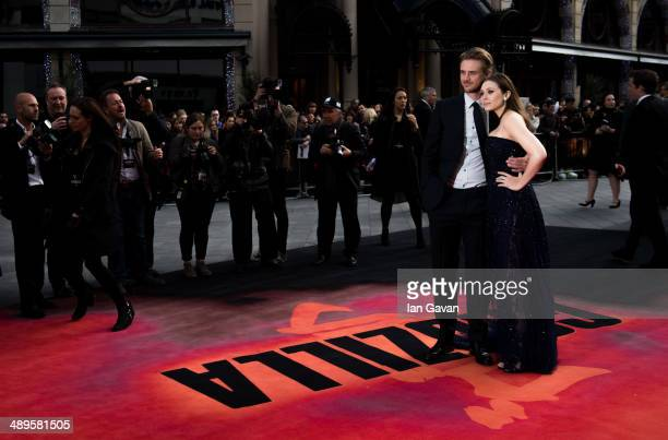 Boyd Holbrook and Elizabeth Olsen attend the European premiere of 'Godzilla' at the Odeon Leicester Square on May 11 2014 in London England