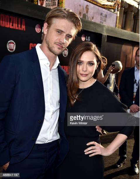 Boyd Holbrook and Elizabeth Olsen attend the premiere of Warner Bros Pictures and Legendary Pictures' 'Godzilla' at Dolby Theatre on May 8 2014 in...