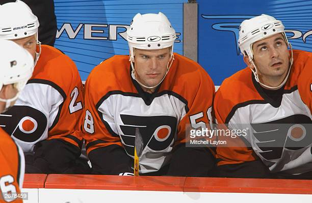 Boyd Kane and Peter White of the Philadelphia Flyers sits on the bench during the NHL preseason game against the Washington Capitals at the MCI...