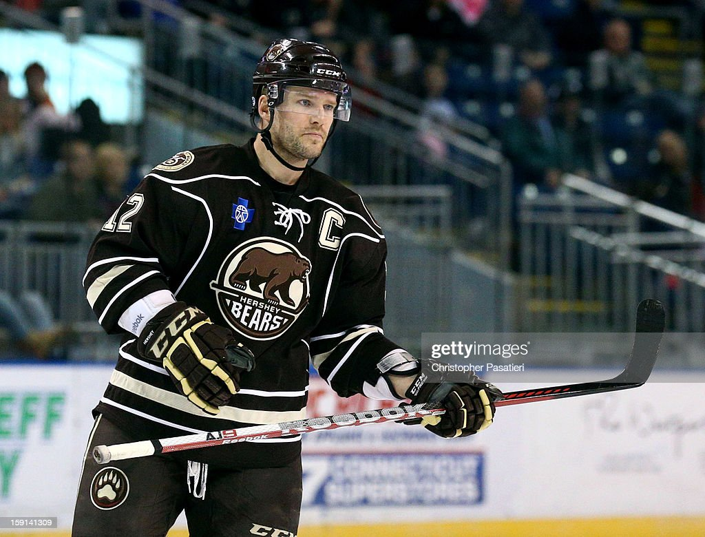 <a gi-track='captionPersonalityLinkClicked' href=/galleries/search?phrase=Boyd+Kane&family=editorial&specificpeople=554419 ng-click='$event.stopPropagation()'>Boyd Kane</a> #12 of the Hershey Bears looks on during his 1000th career American Hockey League game against the Bridgeport Sound Tigers on January 8, 2013 at the Webster Bank Arena at Harbor Yard in Bridgeport, Connecticut.