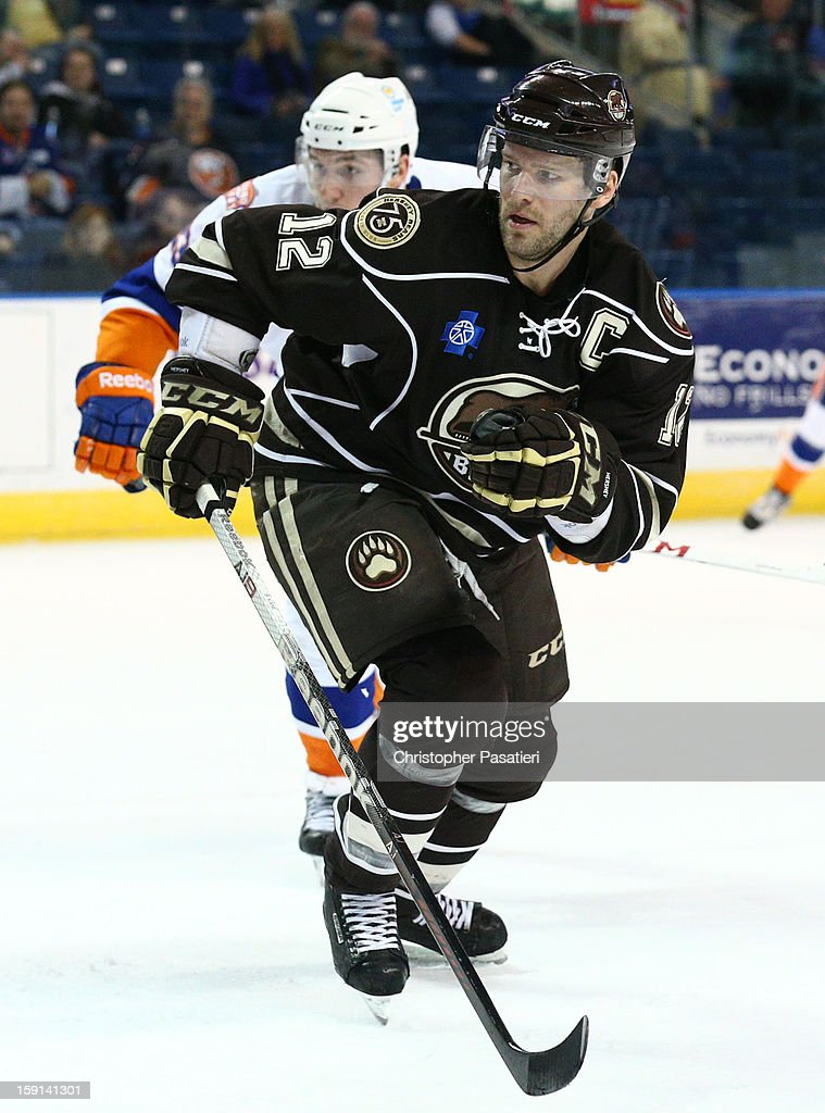 <a gi-track='captionPersonalityLinkClicked' href=/galleries/search?phrase=Boyd+Kane&family=editorial&specificpeople=554419 ng-click='$event.stopPropagation()'>Boyd Kane</a> #12 of the Hershey Bears skates during his 1000th career American Hockey League game against the Bridgeport Sound Tigers on January 8, 2013 at the Webster Bank Arena at Harbor Yard in Bridgeport, Connecticut.
