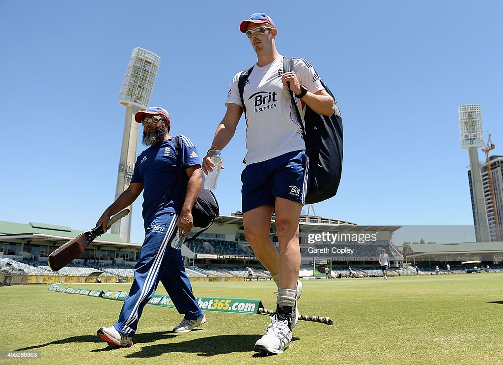 Boyd Rankin of England walks to the nets alongside spin bowling coach Mushtaq Ahmed during an England nets session at WACA on December 12 2013 in...
