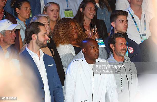Boyfriend Alexis Ohanian coach Patrick Mouratoglou sister Isha Price look on as Serena Williams speaks after winning the Women's Singles Final match...