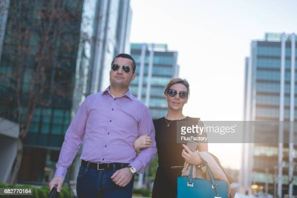Boyfriend and girlfriend walking together in business district