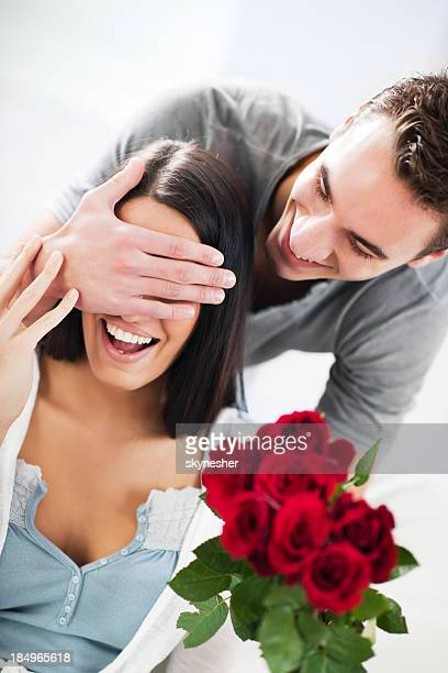 Boyfriend giving his girlfriend a Valentine's present.
