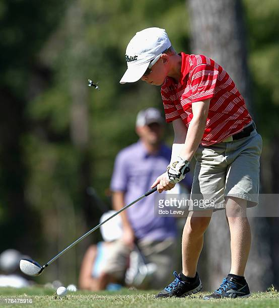 Boys 1011 age group competitor William Choate drives the ball off the tea druig the drive competition during a regional round of the Drive Chip and...