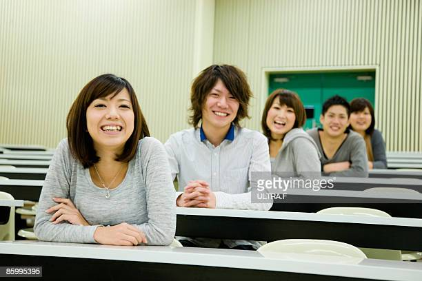 Boys and girls are sitting in the classroom.