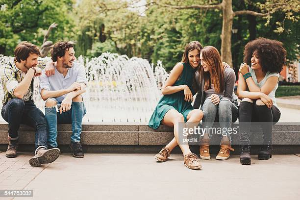Boys and girls flirting in the park
