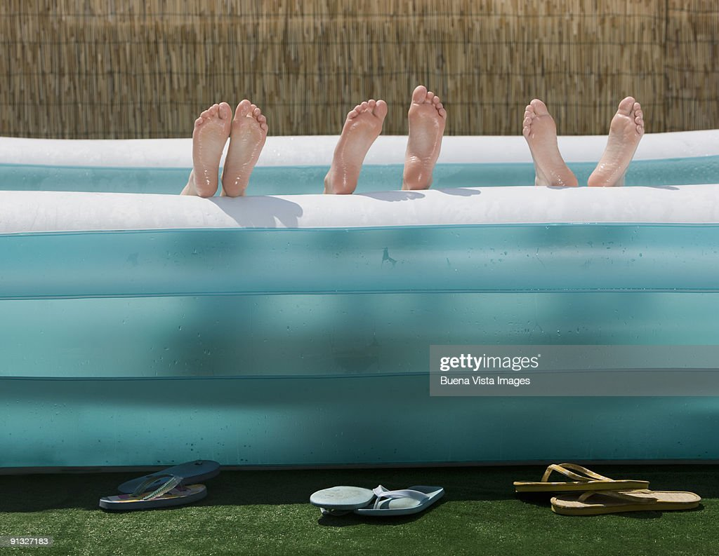 Boys and girls in pool : Stock Photo