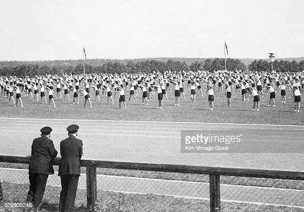 Boys and girls of the Hitler Youth exercise on a parade ground in the mid1030s