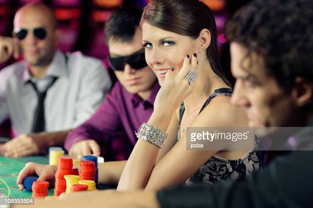 boys and girls playing poker  in casino
