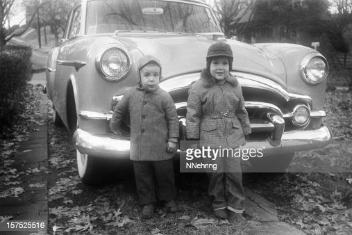 boys and Packard coupe car 1955, retro