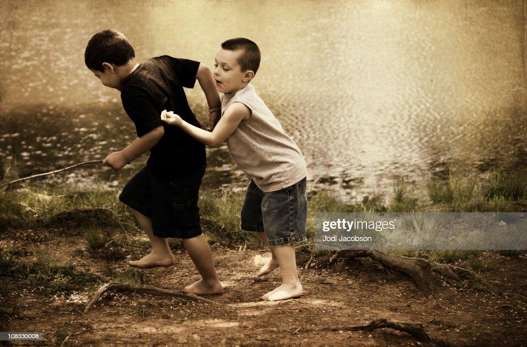 Boys and their sticks : Stock Photo
