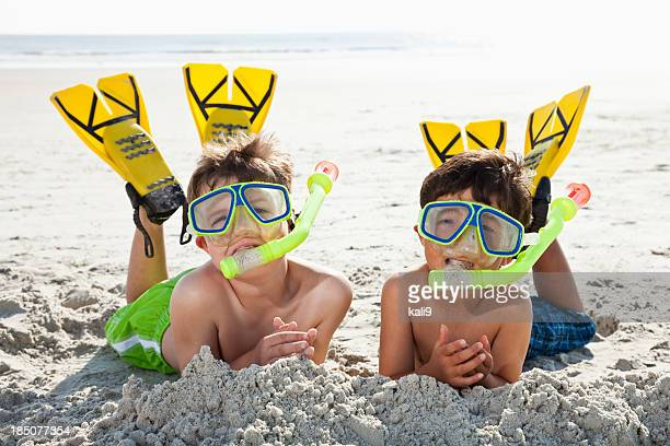 Boys at beach ready to snorkel