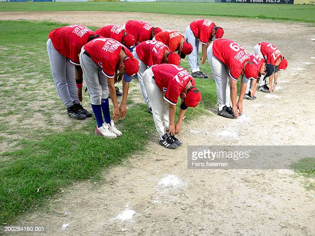 Boys' (8-14) baseball team stretching