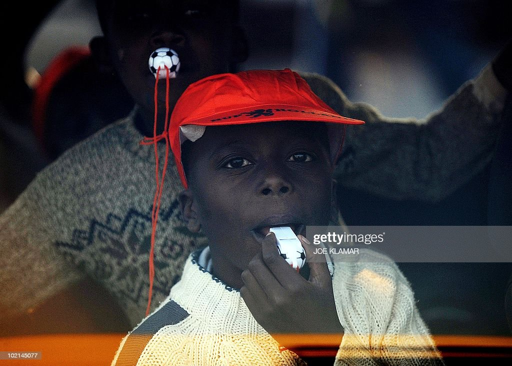 Boys blow whistles from a car at Mamelodi township in Pretoria on June 16, 2010 during the 2010 World Cup football tournament in South Africa.