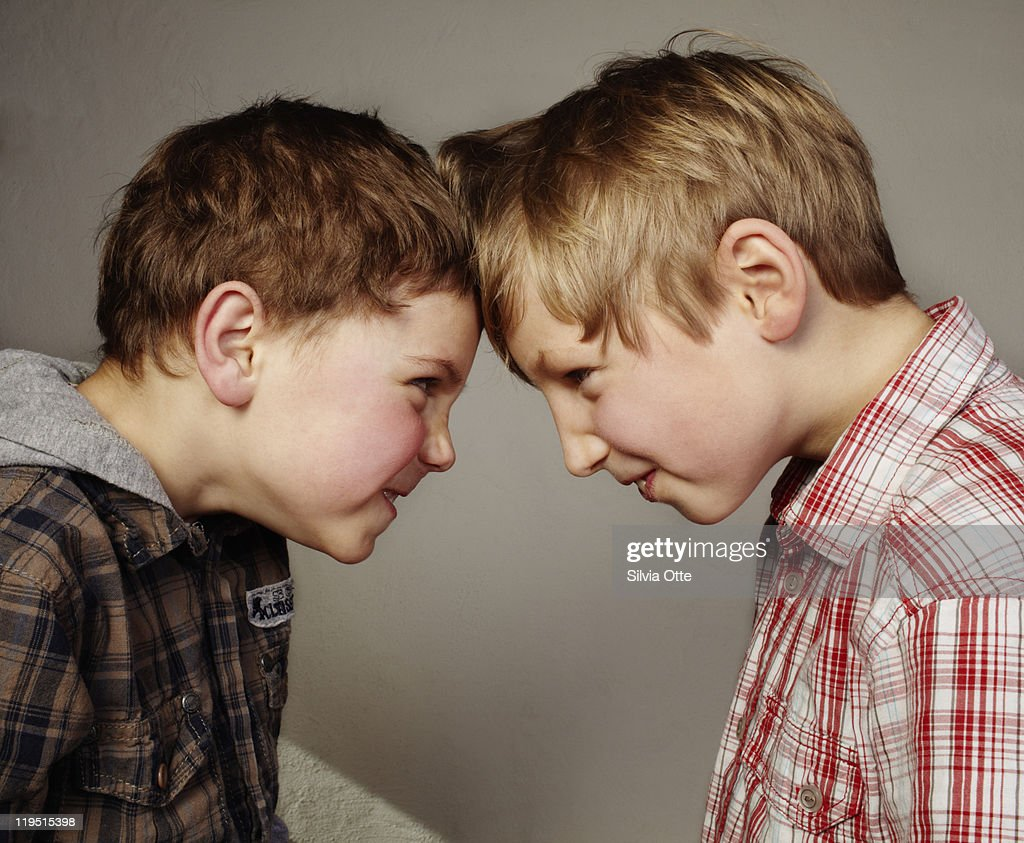 2 boys budding heads : Stock Photo
