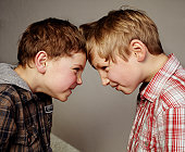 2 boys budding heads