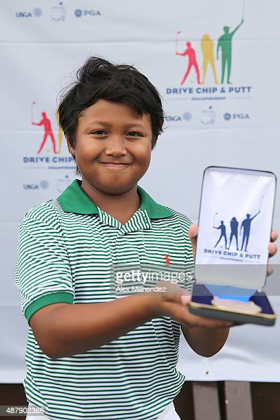 Boys category age 1011 overall winner and chipping and putting champion Nashawn Tyson poses with his award during the regional round of the 2015...