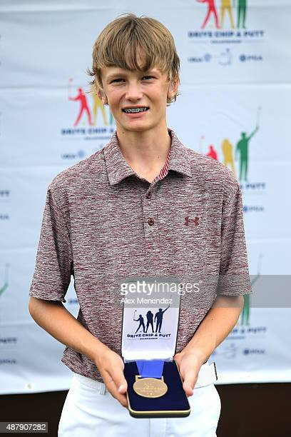 Boys category age 1213 putting champion James Tureskis poses with his award during the regional round of the 2015 Drive Chip and Putt Championship at...
