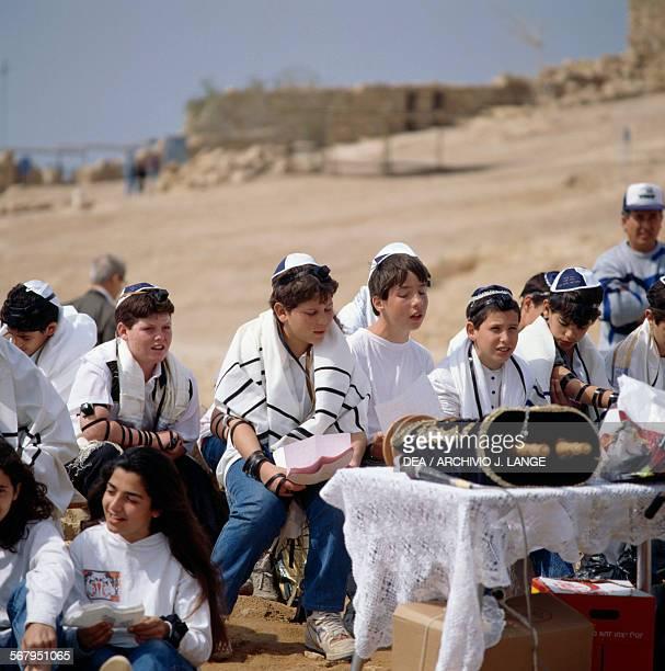 Boys celebrating a collective Bar Mitzvah at Masada Israel