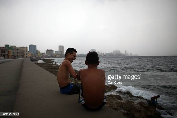 Boys chat after swimming in the Malecon coastal area on September 16 2015 in Havana Cuba Pope Francis is due to make a three day visit to Cuba from...