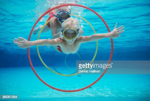 Boys Diving In Pool Swimming Through Underwater Rings Stock Photo Getty Images