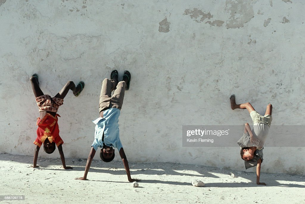 Boys Doing Handstands Against the Wall