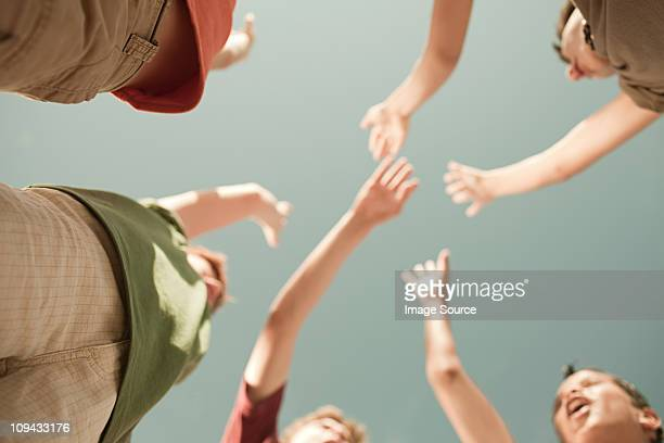 Boys doing high five, low angle view