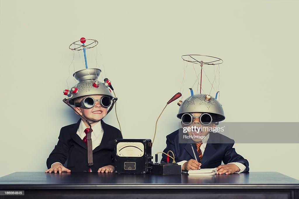 Boys Dressed as Businessmen Wearing Mind Reading Helmets : Stock Photo